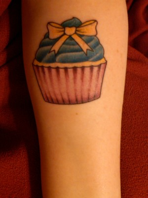 I'm Catzilla and I got this sweet little cupcake tattoo for my 21 birthday.