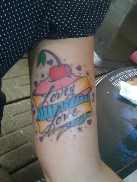 I totally love cupcakes adore my tattoo It was done by Danny Edwards